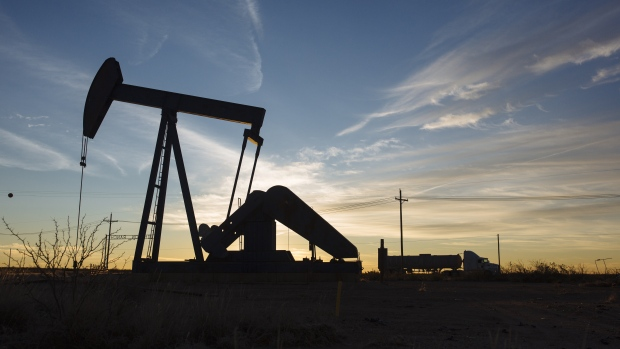 A pump jack stands at dusk in the Permian Basin area in Texas, U.S., Bloomberg/Angus Mordant