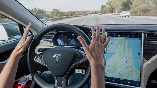 An instrument panel illustrates the road ahead using Autopilot technology in the Model S. Photographer: Christopher Goodney/Bloomberg