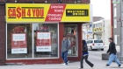 People walk pass a pay day loan store in Oshawa, Ont., on May 13, 2017.