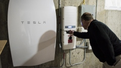 A customer inspects a Tesla Motors Inc. Powerwall unit inside a home in Monkton, Vermont, U.S.