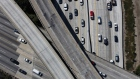 Vehicles move along the Interstate 405 freeway during rush hour in this aerial photograph taken over the Westwood neighborhood of Los Angeles, California, U.S.