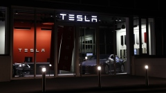 Electrc vehicles stands on display inside a Tesla Inc. store in Bern, Switzerland, on Thursday, Aug. 16, 2018.