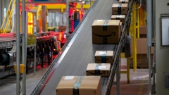 Packages move along a conveyor at the Amazon.com Inc. fulfillment center in Robbinsville, New Jersey, U.S., on Thursday, June 7, 2018.