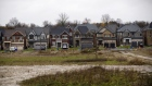 Homes stand beyond an undeveloped plot of land in East Gwillimbury, Ontario, Canada, on Friday, Nov. 2, 2018. STCA Canada is scheduled to release new housing price figures on Dec. 13.