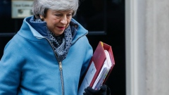 Theresa May, U.K. prime minister, departs number 10 Downing Street to attend a weekly questions and answers session in Parliament in London, U.K., on Wednesday, Feb. 13, 2019.