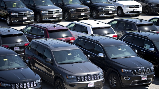 Jeep and Dodge vehicles are displayed for sale at a Fiat Chrysler Automobiles (FCA) car dealership in Moline, Illinois, U.S., on Saturday, July 1, 2017.