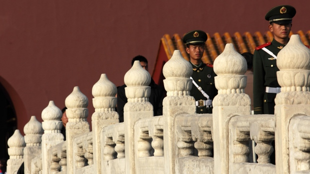 Members of China's People's Liberation Army (PLA) stand guard in front of Tiananmen Gate in Beijing, China, on Thursday, Nov. 8, 2012. China's Communist Party kicked off a congress in Beijing to choose its fifth generation of leaders since taking power in 1949, a decision that will shape the nation's economic and financial policies for the next decade.