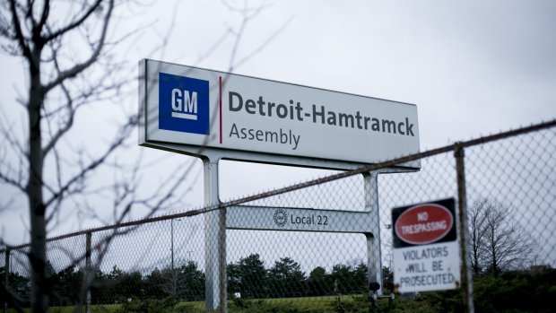Signage stands on display at the General Motors Co. Detroit-Hamtramck assembly plant in Detroit.