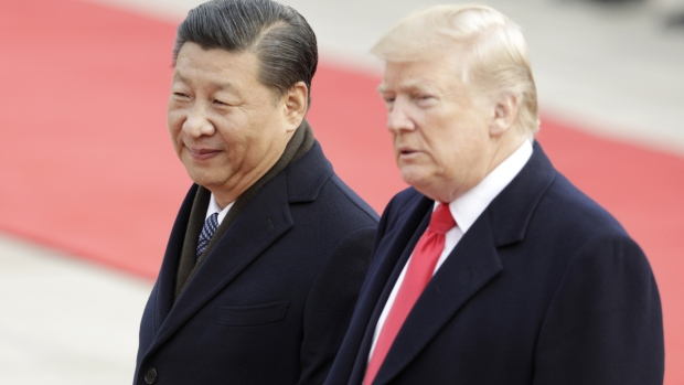 Xi Jinping, China's president, left, and U.S. President Donald Trump look on during a welcome ceremony outside the Great Hall of the People in Beijing, China.