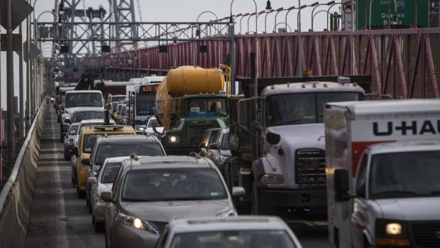 Vehicles sit in traffic while exiting the Williamsburg Bridge in New York, U.S., on Wednesday, Dec. 20, 2017. New York's Metropolitan Transportation Authority decided to close the L line entirely to work on extensive repairs full time, instead of a one-track-at-a-time closing that would take three years. The tunnel, which carries passengers under the East River from Brooklyn to Manhattan, will close for 15 months in April 2019. The Williamsburg Bridge will see a dramatic increase in traffic under the new plan.
