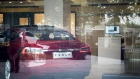 A Tesla Inc. Model S electric vehicle sits on display at the company's showroom in Beijing, China, on Saturday, July 7, 2018. As a trade war looms, one of Chinese President Xi Jinping's biggest weapons could be boycotts of American brands by his country's legion of consumers.