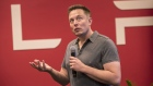 Elon Musk, chairman and chief executive officer of Tesla Motors, speaks during an event the company's headquarters in Palo Alto, California, U.S.