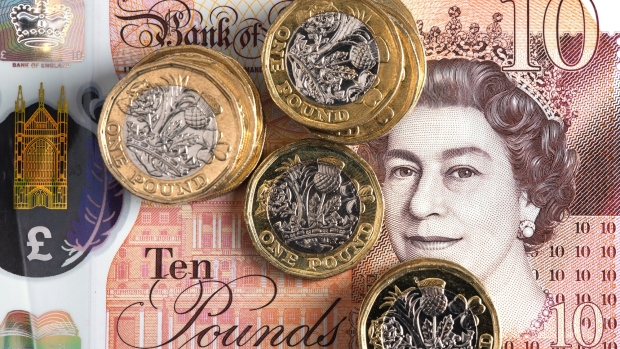 https://www.bnnbloomberg.ca/polopoly_fs/1.1227115!/fileimage/httpImage/image.jpg_gen/derivatives/landscape_620/a-collection-of-british-one-pound-coins-sit-on-a-british-10-pound-banknote-in-this-arranged-photograph-in-london-u-k-on-tuesday-feb-12-2019-the-pound-was-set-for-its-biggest-weekly-decline-in-almost-four-months-after-lawmakers-dealt-u-k-prime-minister-theresa-may-another-defeat-in-parliament-as-they-refused-to-endorse-her-brexit-strategy.jpg