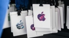 Apple Inc. logos are displayed on badges ahead of an event in the Brooklyn borough of New York, U.S., on Tuesday, Oct. 30, 2018. The iPad Pro update comes at an important time for the device, which hasn't been refreshed since mid-2017. While the tablet market is contracting overall, the iPad has been slowly regaining momentum thanks to new software and lower-priced models, but also because competitors like Amazon.com Inc. and Samsung Electronics Co. haven't wowed the market lately.