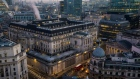 The Bank of England (BOE) stands illuminated at dawn in the City of London, U.K., on Monday, Feb. 25, 2019. The U.K. and U.S. sought to allay fears of disruption in the multitrillion-dollar derivatives market, vowing to put in place emergency policies to ensure trading continues uninterrupted in the event of a no-deal Brexit.