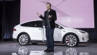 Elon Musk, chairman and chief executive officer of Tesla Motors Inc., unveils the Model X sport utility vehicle (SUV) during an event in Fremont, California, U.S., on Tuesday, Sept. 29, 2015.