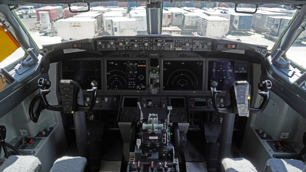 The cockpit of a grounded Lion Air Boeing Co. 737 Max 8 aircraft is seen at terminal 1 of Soekarno-Hatta International Airport in Cenkareng, Indonesia, on Tuesday, March 15, 2019. Sunday's loss of an Ethiopian Airlines Boeing 737, in which 157 people died, bore similarities to the Oct. 29 crash of another Boeing 737 Max plane, operated by Indonesia's Lion Air, stoking concern that a feature meant to make the upgraded Max safer than earlier planes has actually made it harder to fly.