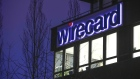 An logo sits above illuminated office windows at the Wirecard AG headquarters at dawn in the Aschheim district of Munich, Germany, on Tuesday, Feb. 12, 2019. Wirecard broke federal securities law by failing to act on an executive's misconduct and misleading investors about it, a complaint filed Feb. 8 in the Central District of California alleges.