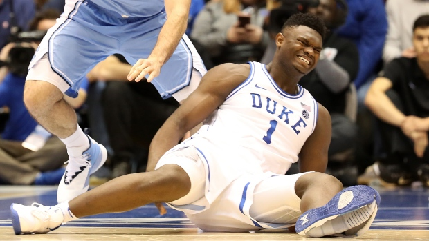 6cfcff7d7af Zion Williamson reacts after falling as his shoe breaks in the first half  of a game in Durham