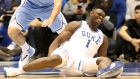 Zion Williamson reacts after falling as his shoe breaks in the first half of a game in Durham, North Carolina on Feb. 20, 2019.