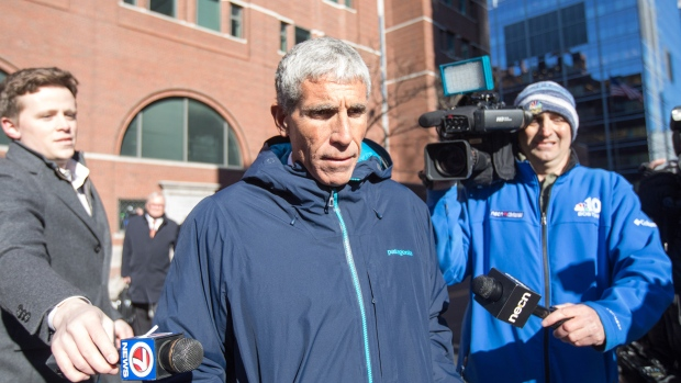 "William ""Rick"" Singer leaves Boston Federal Court on March 12, 2019."