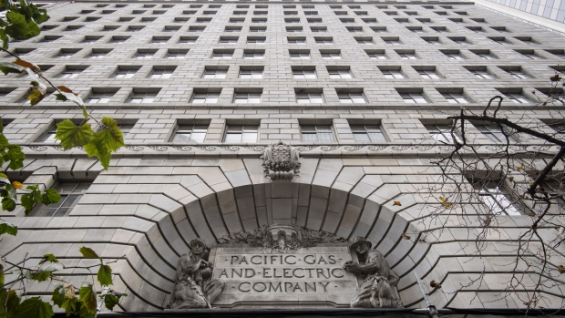 Signage is displayed on the exterior of Pacific Gas and Electric Corp. (PG&E) headquarters in San Francisco, California, U.S., on Monday, Jan. 14, 2019. PG&E Corp. said it will file for bankruptcy in California after the cost of wildfires left it with potential liabilities of $30 billion or more, gutting its share price and prompting the departure of its chief executive officer.