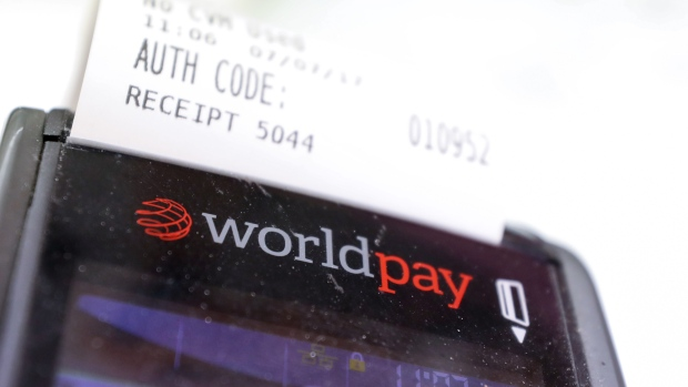 A Worldpay Group Plc card payment machine prints a receipt in a retail outlet in London, U.K., on Friday, July 7, 2017. Vantiv Inc., the largest U.S. merchant acquirer, agreed Wednesday to buy London's Worldpay for 7.7 billion pounds ($9.9 billion) to gain greater exposure to e-commerce retailers and small businesses.