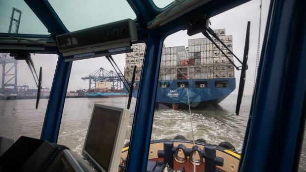 A Svitzer tug boat guides the Dali container ship, operated by Maersk Line AS, at the Port of Felixstowe Ltd., a subsidiary of CK Hutchison Holdings Ltd., in Felixstowe, U.K.