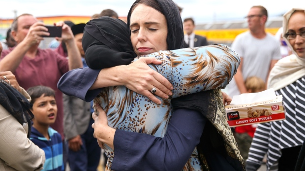 WELLINGTON, NEW ZEALAND - MARCH 17: Prime Minister Jacinda Ardern hugs a mosque-goer at the Kilbirnie Mosque on March 17, 2019 in Wellington, New Zealand. 50 people are confirmed dead and 36 are injured still in hospital following shooting attacks on two mosques in Christchurch on Friday, 15 March. The attack is the worst mass shooting in New Zealand's history. (Photo by Hagen Hopkins/Getty Images) Photographer: Hagen Hopkins/Getty Images AsiaPac