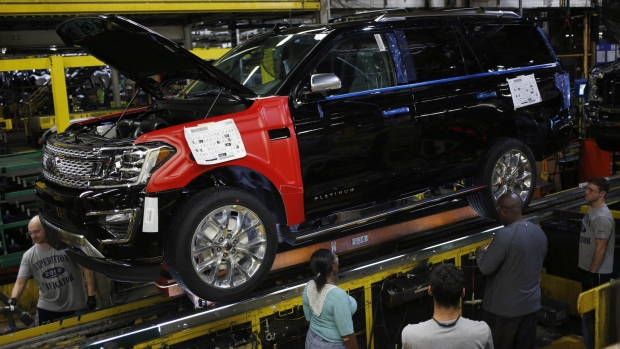 Employees work on a Ford Expedition on the Kentucky plant assembly line in Louisville. Photographer: Luke Sharrett/Bloomberg