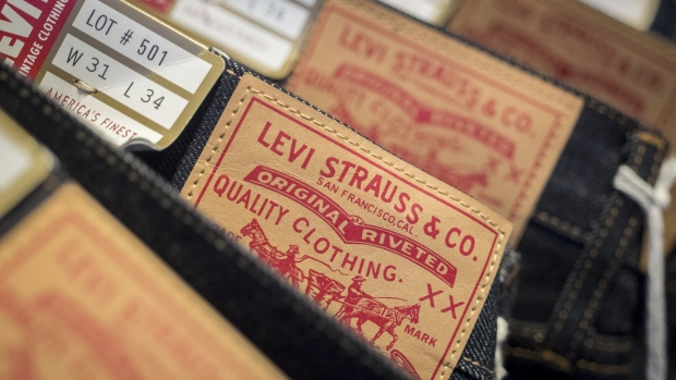 Levi Strauss & Co. labels are seen on jeans for sale inside the company's flagship store in San Francisco, California, U.S., on Monday, March 18, 2019. Levi Strauss & Co.'s initial public offering, currently set at 36.7 million shares seen pricing at $14 to $16 each, is expected to price on March 20 according to the NYSE website.