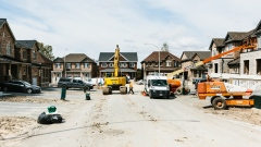 Machinery stands in a housing development under construction in Whitby, Ontario, Canada, on Wednesday, May 10, 2017. Ontario officials announced a slew of measures on Thursday for Toronto and surrounding areas meant to control what some economists, investors and policy makers call a price bubble that's putting the broader economy at risk.