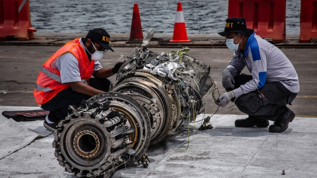 A grounded Lion Air Boeing Co. 737 Max 8 aircraft sits on the tarmac at terminal 1 of Soekarno-Hatta International Airport in Cenkareng, Indonesia, on Tuesday, March 15, 2019. Sunday's loss of an Ethiopian Airlines Boeing 737, in which 157 people died, bore similarities to the Oct. 29 crash of another Boeing 737 Max plane, operated by Indonesia's Lion Air, stoking concern that a feature meant to make the upgraded Max safer than earlier planes has actually made it harder to fly. Photographer: Dimas Ardian/Bloomberg