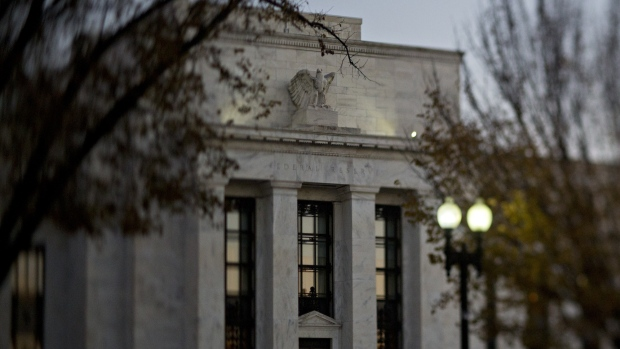 (EDITORS NOTE: Image was created using a variable planed lens.) The Marriner S. Eccles Federal Reserve building stands in Washington, D.C., U.S., on Friday, Nov. 18, 2016. Federal Reserve Chair Janet Yellen told lawmakers on Thursday that she intends to stay in the job until her term expires in January 2018 while extolling the virtues of the Fed's independence from political interference.