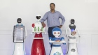 an McGowan CEO of Autonetics Universe is pictured with robots