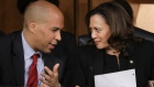 WASHINGTON, DC - SEPTEMBER 6: (L-R) Sen. Cory Booker (D-NJ) and Sen. Kamala Harris (D-CA) talk with each other as they listen to Supreme Court nominee Judge Brett Kavanaugh testify before the Senate Judiciary Committee on the third day of his Supreme Court confirmation hearing on Capitol Hill September 6, 2018 in Washington, DC. Kavanaugh was nominated by President Donald Trump to fill the vacancy on the court left by retiring Associate Justice Anthony Kennedy. (Photo by Drew Angerer/Getty Images)