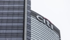 The Citigroup Inc. logo is displayed atop the Champion Tower, right, in Hong Kong, China, on Saturday, March 23, 2019. Citigroup, the global investment bank with a major presence in Asia, has ousted eight equities traders in Hong Kong and suspended three others after a sweeping internal investigation into its dealings with some clients, people familiar with the matter said.