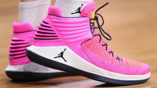 3c453a4bebeb Nike Air Jordan 32 sneakers and socks featuring the Jumpman logo.  Photographer  Tom Pennington