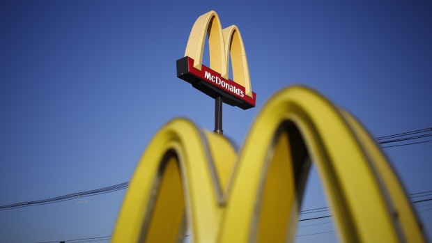 Signage is displayed outside a McDonald's Corp. fast food restaurant in Louisville, Kentucky, U.S.