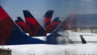 Delta Air Lines Inc. planes are seen reflected at Salt Lake City International airport (SLC) in Salt Lake City, Utah, U.S., on Thursday, July 5, 2018.