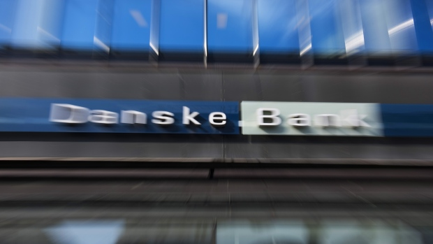 The logo of Danske Bank A/S sits on display in this motion blur effect photo outside a bank branch in Copenhagen, Denmark.