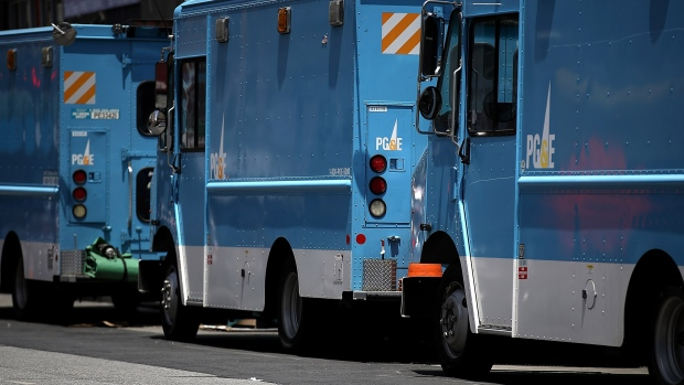 Pacific Gas and Electric (PG&E) trucks sit parked on a street on June 18, 2018 in San Francisco, California.