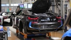 A BMW i8 hybrid electrical automobile stands on an assembly line trolley at the Bayerische Motoren Werke AG factory in Leipzig, Germany.