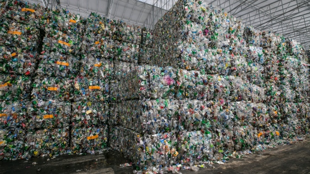 Bales of compressed plastic waste stand at a Junyoung Industrial facility in Gimpo, South Korea, on Thursday, April 19, 2018.
