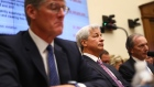Jamie Dimon, center listens during a House Financial Services Committee hearing in Washington on April 10.