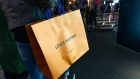 A shopper carries a LVMH Moet Hennessy Louis Vuitton SE branded shopping bag on Canton Road in the Tsim Sha Tsui district of Hong Kong, China, on Sunday, Feb. 3, 2019. The week-long Lunar New Year holiday, starting Feb. 4, will provide the next litmus test of the resilience of the Chinese shopper. The seven-day period sees hundreds of millions of people travel within the country to see relatives, fly overseas to takevacations - and open their wallets to buy gifts. Photographer: Anthony Kwan/Bloomberg