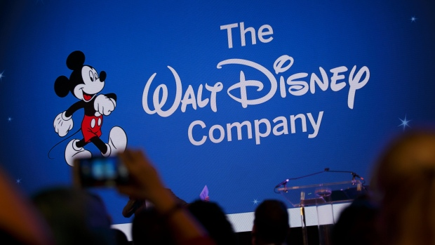 Walt Disney Co. signage is projected during the D23 Expo 2017 in Anaheim, California, U.S., on Saturday, July 15, 2017. Burbank, California-based Disney will entertain D23 guests this weekend with sneak previews of movies as well as the opportunity to purchase exclusive merchandise at dozens of shops situated in the Anaheim Convention Center.
