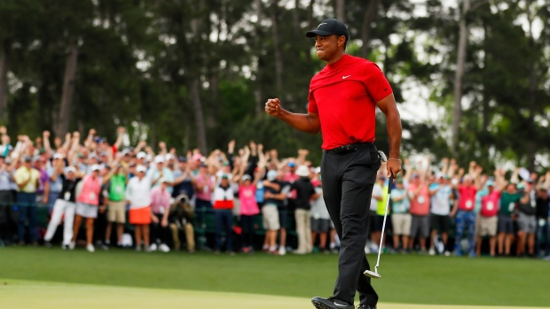 AUGUSTA, GEORGIA - APRIL 14: Tiger Woods of the United States celebrates after sinking his putt on the 18th green to win during the final round of the Masters at Augusta National Golf Club on April 14, 2019 in Augusta, Georgia. (Photo by Kevin C. Cox/Getty Images) Photographer: Kevin C. Cox/Getty Images North America