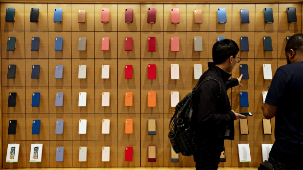 Customers browse Apple Inc. smartphone cases during a sales launch at a store in Chicago, Illinois