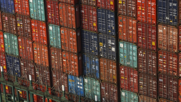 Shipping containers sit stacked on the Hyundai Force container ship at the Jawaharlal Nehru Port, operated by Jawaharlal Nehru Port Trust (JNPT), in Navi Mumbai, Maharashtra, India, on Saturday, Dec. 16, 2017. Many of the cargo containers passing through India's busiest port in Mumbai have a small piece of Japan Inc. attached: Devices from NEC Corp. that can be tracked as the containers rumble through the interior of Asia's third-largest economy.